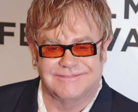 Elton John Wearing A Suit And Tie